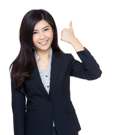 extol: Asian businesswoman thumb up gesture Stock Photo