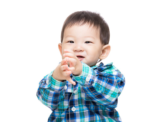 Asia baby boy clapping hand photo