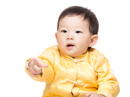 Chinese baby boy finger pointing toward