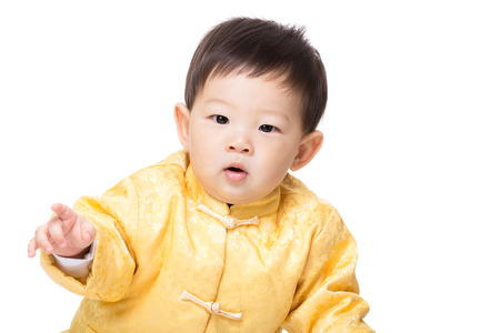 Asia baby boy with golden chinese costume photo