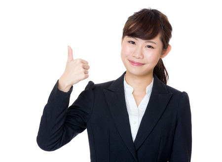 extol: Asia businesswoman thumb up Stock Photo