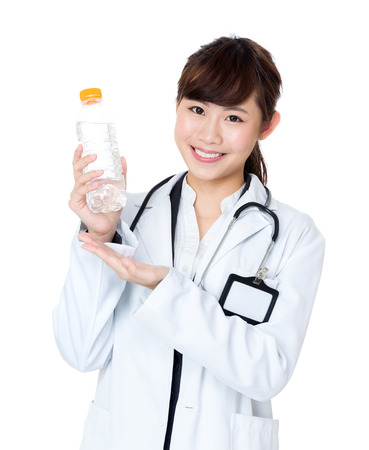 Asia female doctor holding water bottle photo