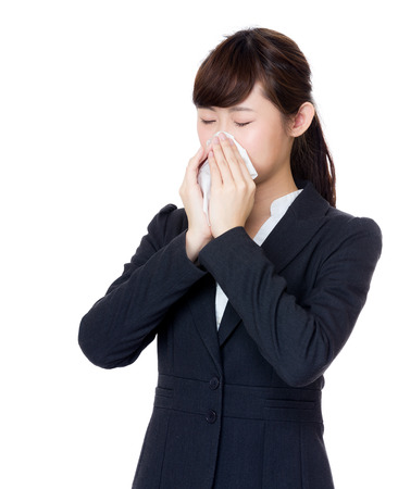 Asia businesswoman sneeze photo