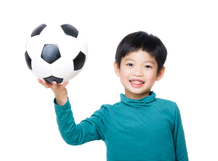Asia little boy holding with soccer ball photo