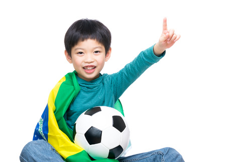 Asia little boy with brazil flag and soccer ball photo