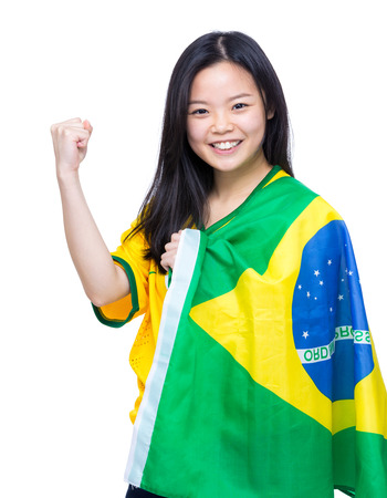 Excited asia female football supporter photo