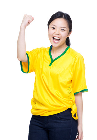 Excited asian female football supporter photo