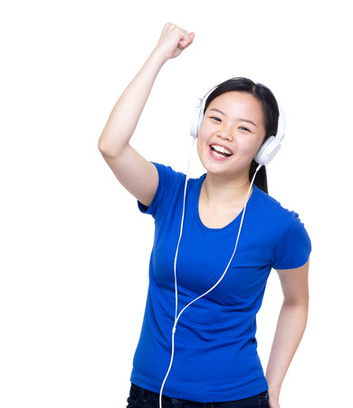 listen fist: Asia woman listen to rock music with headphone Stock Photo