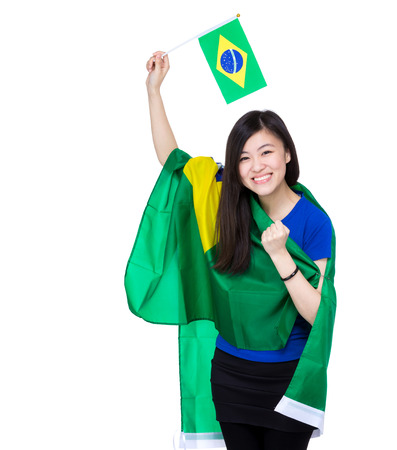 Asian excited woman drape with Brazil flag photo