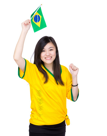 Excited Asia woman hold Brazil flag photo