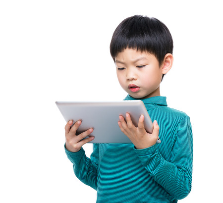Asia little boy reading on tablet photo
