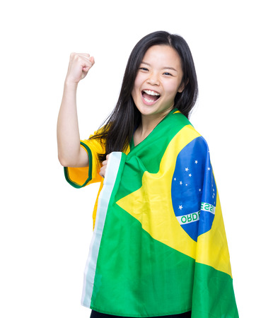 Excited asia woman draped with Brazil flag photo