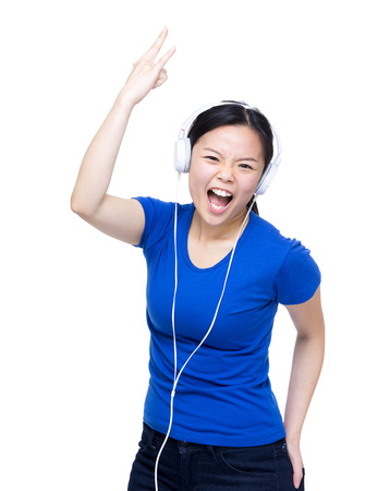 Asia woman listen to music with headphone
