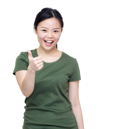 Excited asia woman two hand with thumb up