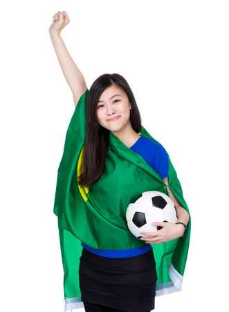 Asia excited woman with Brazil flag and football photo