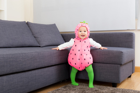 asian baby girl: Asia baby girl with strawberry dressing  Stock Photo