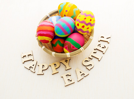 Colourful easter egg with wooden text photo