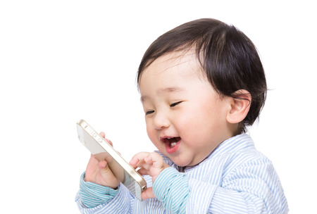 people on phone: Asian baby boy play with mobile phone