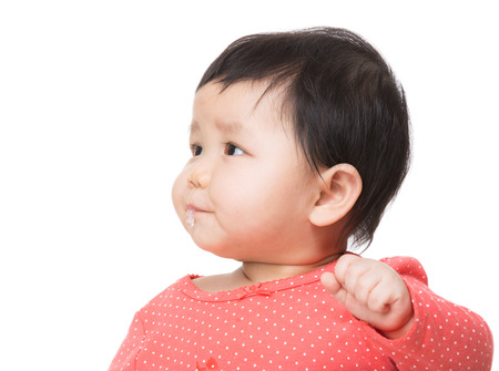 Asian baby girl drooling Stock Photo