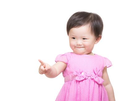 toward: Asia baby girl finger point toward Stock Photo