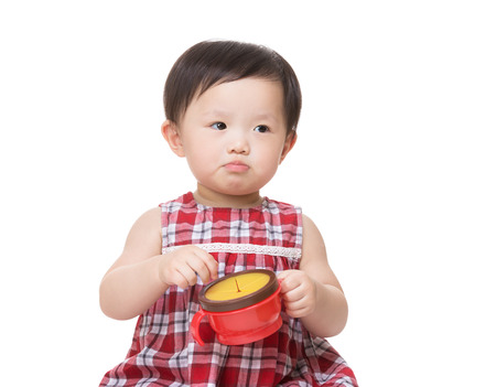 Asia baby girl with snack box photo