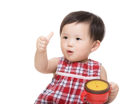 Asia baby girl with snack box and thumb up