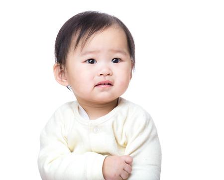 Asian baby girl feeling sad