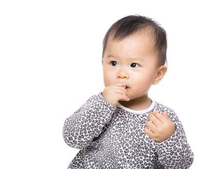 Asia baby girl suck finger into mouth photo