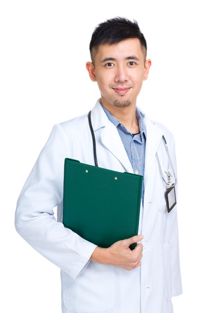 Profession asian doctor holding clipboard photo