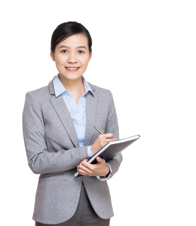 Asian business woman recording on notebook photo