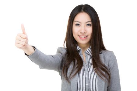 extol: Asian businesswoman thumb up