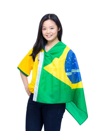 Excited football supporter with Brazil flag photo