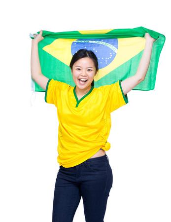 Asia female soccer fans holding Brazil flag photo