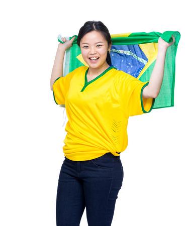 Asia female soccer fans holding Brazil flag Stock Photo - 28177822