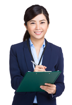 Businesswoman writing on clipboard photo