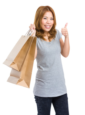 Shopping woman showing thumb up photo