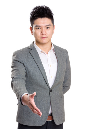 Successful businessman giving hand  photo