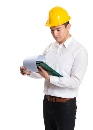 Surveyor reading on clipboard photo