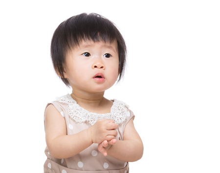 Asia baby girl clapping hand photo