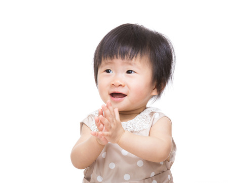 Excited baby girl clapping hand