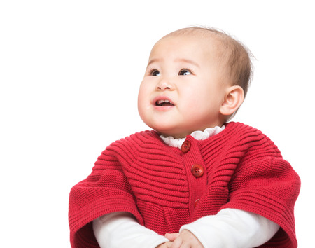 no teeth smile: Chinese baby girl looking at the top
