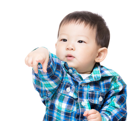Baby child with funny hand gesture photo