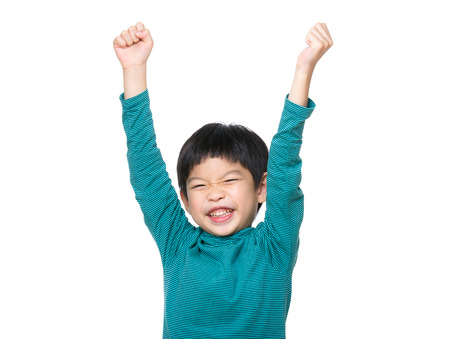 cheer: Asia little boy hand up Stock Photo