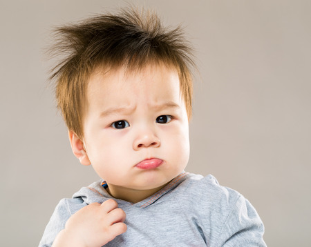 Little boy pouting Stock Photo