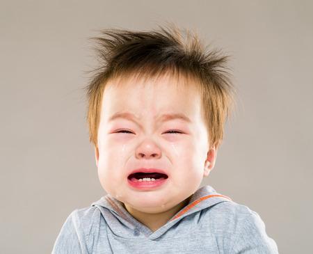 tearful: Asia baby boy crying