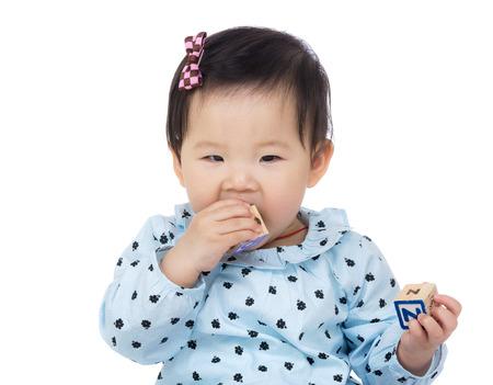 teething: Little girl with teething Stock Photo