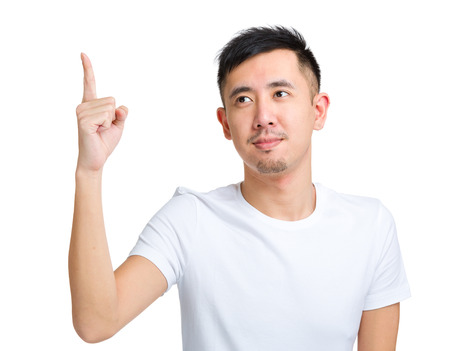 front raise: Young man pointing upward Stock Photo