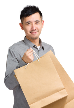 Young man with shopping bag photo