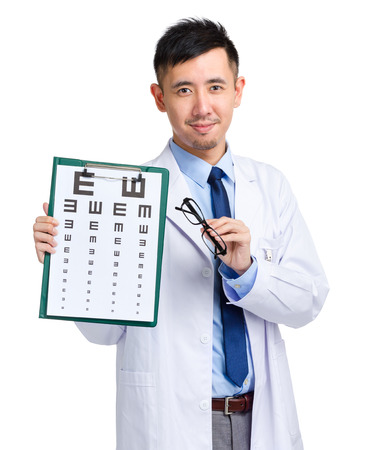 Male oculist holding eye chart and glasses photo