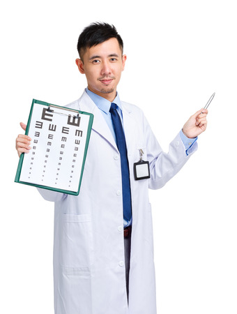 Male doctor holding optometry chart and pen pointing up photo